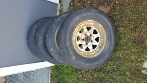 Uses p215/75/r15 car trailer tires on rims