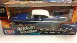 1958 Plymouth Fury.....1/18 Die-cast. ..