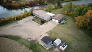 Picturesque acreage 1650 sq ft home /elevated deck over river