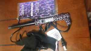 Royale infinite curling wand.