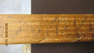 70's Hockey stick with multiple autographs.