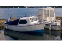 Arran type fishing boat with Tohatsu 9.8hp four stroke on a trailer