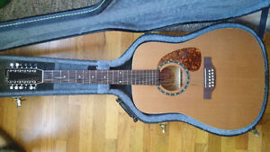 $300 (OBO)- 12 String acoustic Guitar BRAND NEW - Made In Canada