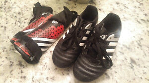 Girls cleats and pads - Size 1 Kitchener / Waterloo Kitchener Area image 1