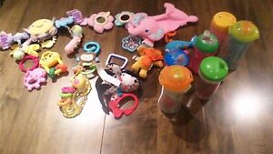 various baby toys and sippy cups