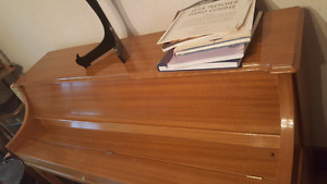 Brown Wooden Piano w/ piano stand, bench, and music
