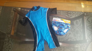 Swim diaper and swimsuit with floater inside