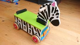 Wooden ride on zebra