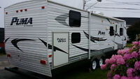 2010 Palomino Puma 30 ft. trailer with slide and Quad bunk house
