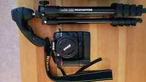 For Sale! !! Nikon D7000 with grip and 35mm f1.8 lens .