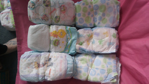 30 Huggies and Pampers Size 2 Diapers