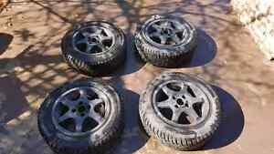 Winter tires 185 / 65 R 14 86 Q with winter rims.