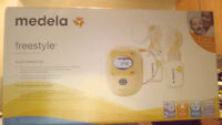 Medela Freestyle Breastpump (never been opened)