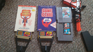 Couple nintendo games and 2 game genies with code books