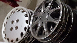 "Full set of four 14"" hubcaps or wheel covers"
