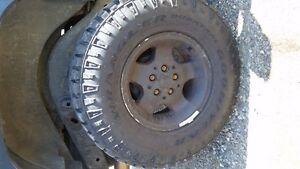 GOODYEAR WRANGLER DURATRAC winter studded tires on Jeep rims