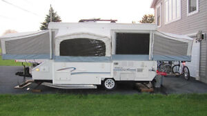 Pop up camper with slide out