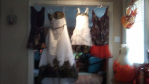 Camo wedding dress with matching flower girl and bridesmaids dre