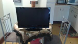 T.V. and black and crome lamps for sale