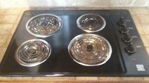 Black finish wall mount overn and counter top stove diswasher.