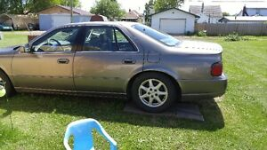 1999 Cadillac Seville STS Sedan for PARTS 500.00 0b0