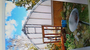 Beautifully stained custom built gothic arch wooden greenhouses