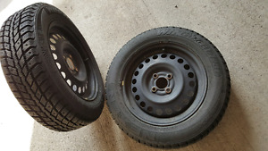 FS ; set of four Winter tires 185/65/15 with Nissan hubcaps