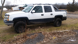 2006 Chevy avalanche lifted  3000 firm firm