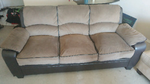 Brown apartment sized couch
