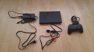 PlayStation 2 SLIM + 12 games + 1controller + 3 memory cards