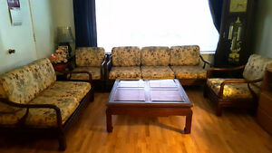 Nara solid wood chairs, sofas and coffee table with glass top