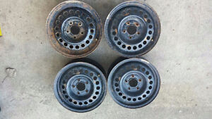 4 rims . 5 x 115/ R15, $ 85.00 or best offer must sell!