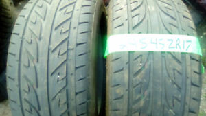 Two Low millage 245 45 ZR 17 all season tires,
