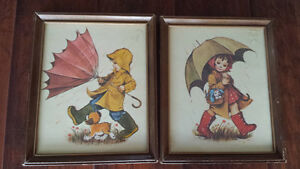 2 prints children in rain coats with dog and cat