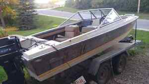 Open bow Tri hill boat with dual axel trailer