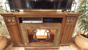 Wood tv console with stone surround