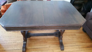 large solid wood dining table w/ two leaves