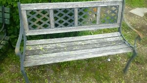 Four wrought iron garden benches