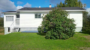 Spacious house with detached garage in quiet picturesque region