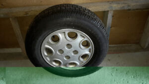 All season tire on rim- great as a spare