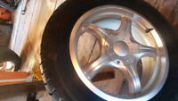 four winter tires with alloy rims