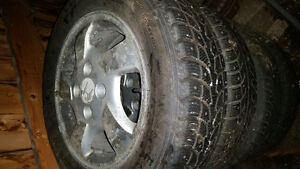 """15"""" studded winter tires on rims"""