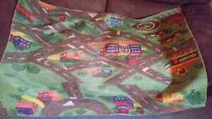 2 rubber playmats  two for $25 or $15 each.
