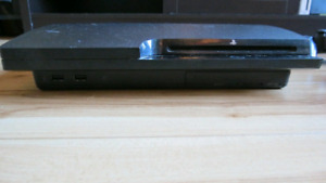 Slim PS3 with Wireless Controllers & Games