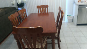 Almost new hard wood dinning table set (with 6 chairs)