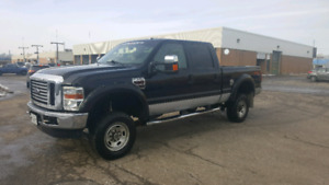 Lifted F-350. 2 sets of tires