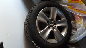 4 OEM BMW rims with Dunlop snow tires