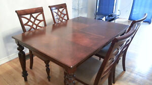 hardwood dining set with 4 chars and sideboard