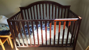 Adjustable crib that doubles as a starter bed.