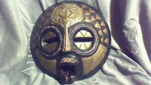 AFRICAN CARVED WOOD MASK WITH BRASS INLAY AND COLOR BEADED